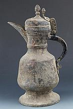 A RARE AND UNUSUAL HAND MADE MONGOLIAN BRONZE WATER POT WITH COVER