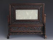 A FINELY CARVED JADE AND REDWOOD TABLE PLAQUE