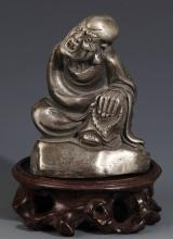 A FINELY CARVED SILVER PLATED BRONZE ROHAN MODEL