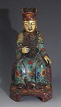 A FINELY CARVED CLOISONNÉ ENAMEL BRONZE DEITY