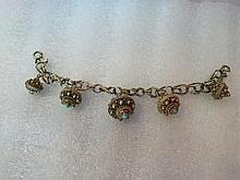 CIRCA 1920S EASTERN EUROPEAN VERMEIL BRACELET, A FINE EASTERN EUROPEAN GOLD AND STERLING VERMEIL BRACELET, INTRICATELY CRAFTED BELLS IN WIRE, NATURAL TURQUOISE ON BELL TIP. 7 1/2