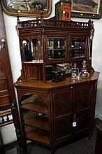 Late Victorian carved walnut salon cabinet