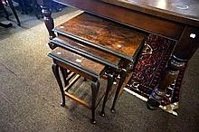 Early 20th Century figured walnut nest of 3 tables
