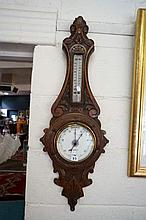 Vic carved oak aneroid barometer