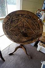 Georgian oak tilt top table, carved later in