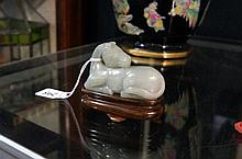 Jade horse on rosewood stand
