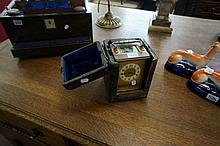 Vic brass carriage clock in leather case