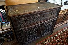 C18th Continental carved oak lift top cupboard