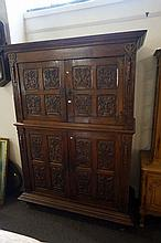 C18th French carved oak 4 door 2 sectional cupboard