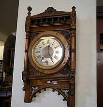 Late Vic oak Gothic style wall clock with engine turned silver dial