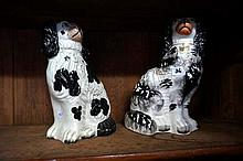 2 similar staffordshire black & white dogs