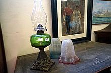 Green glass cast iron based kero lamp & 2 Victorian shades