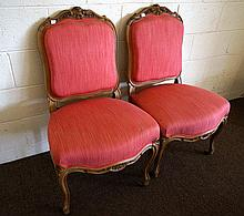 Pr antique French carved walnut & padded back chairs