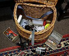 Cane fishing basket containing numerous reels inc Pflueger supreme multipli
