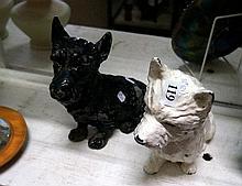 Pr early 20th Century cast iron black & white Scottie dogs