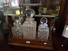 Unusual Victorian oak & hobnail crystal tantalus with 3 decanters