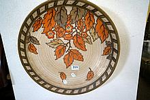 Charlotte Rhead signed charger decorated with autumn leaves