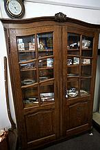 French oak 2 door bookcase with bevilled edge glass
