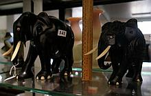 2 large vintage ebony elephants with ivory tusks