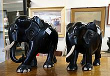2 large ebony elephants with ivory tusks