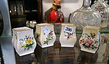 4 Royal Doulton minature floral bud vases