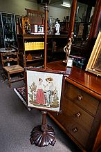 Early Victorian mahogany  polescreen with needlework panel of male ^-^^+^& female