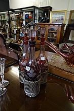 Victorian EP 3 bottle tanatalus with red overlaid etched decanters, 1 chipp