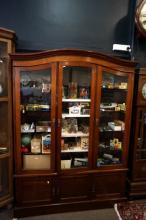 Large early C20th walnut 3 door showcase with 3 cupboard base