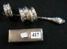 Vic s/silver top rectagular jar, button hook & 3 s/silver napkin rings