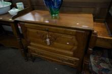 French oak drop front cabinet with lower drawer