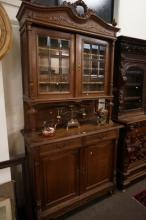 C19th French carved oak court cabinet with bevilled glass doors
