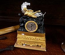 C19th French Empire ormolu mantle clock surmounted by man & horse