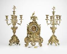 A Louis XV-style mantel clock and garniture