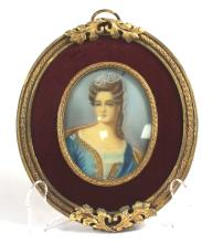 BRONZE FRAME WITH MINIATURE PORTRAIT OF A WOMAN ON