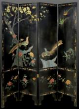 A FOUR-PANEL BLACK LACQUER CHINESE SCREEN