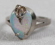 PEAR SHAPED SYNTHETIC OPAL RING WITH TWO ACCENT CUBIC