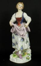 MEISSEN FIGURE OF WOMAN HOLDING DRESS