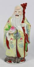 CHINESE PORCELAIN FIGURE OF A MAN HOLDING CANE