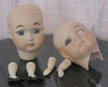 antique doll parts: 2 bisque heads and porcelain arms and legs
