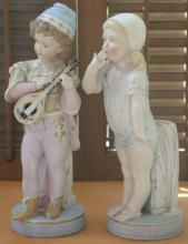 pair of antique bisque porcelain statues, possibly German or French