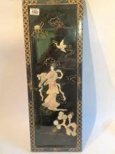 Black lacquered oriental panel with shell decoration. Measures 75x25cm