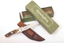 A Remington hunting knife in excellent condition with sheath, sharpening st