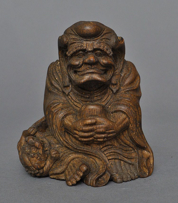 A Chinese Bamboo Carved Smiling Luohan