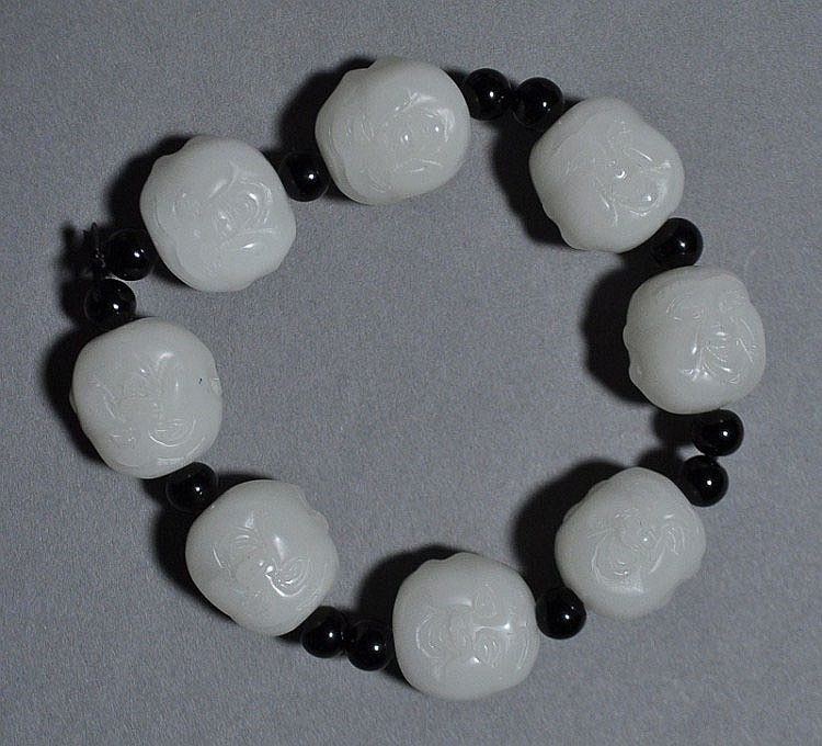 A Chinese Jade Carved Bead Bracelet with 8 Luohan faces
