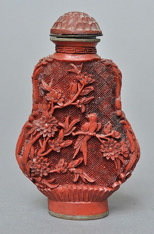 A Chinese Carved Cinnabar Snuff Bottle
