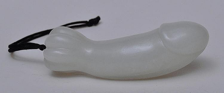 A Fine Chinese Jade Carved Lingam with 8-Lobed Floral Base