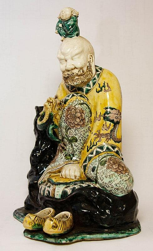 A Chinese Porcelain Figure of Luohan