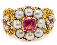 A VICTORIAN RUBY AND ½ PEARL RING