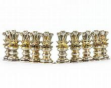 A SET OF GARRARD SILVER TABLE PLACEHOLDERS
