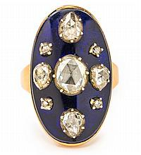 AN ANTIQUE OVAL DIAMOND AND ENAMEL RING